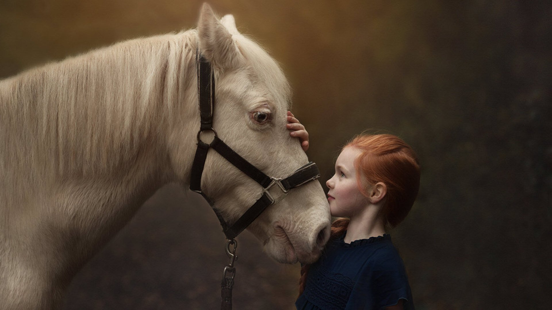 girl with red hair a white horse